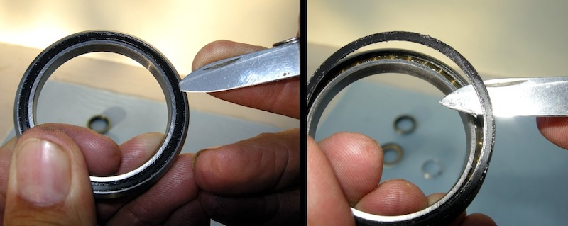 Photo 4 - CAREFULLY find the outer edge of the seal and pry it out of its groove.NEVER touch the inner lip of the seals with a tool.